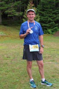 Dave Horgan celebrates after completing the half marathon Sunday.